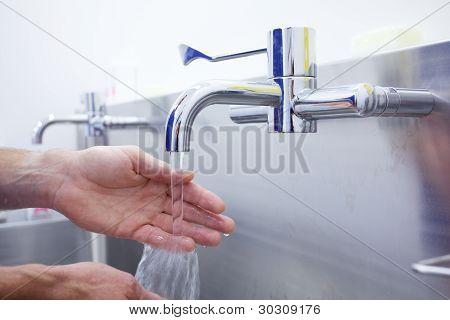 Surgeon Washing Hands Prior To Operation