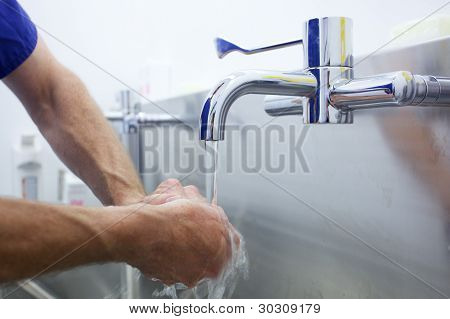 Surgeon Scrubbing Hands For Operation