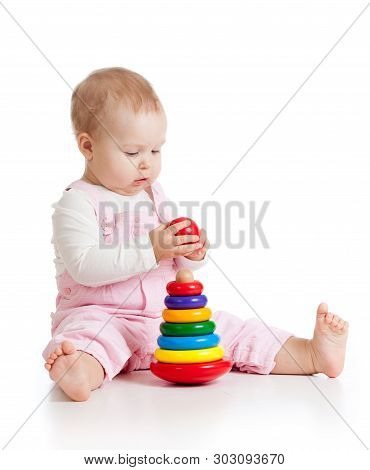 Nursery Baby Playing With Pyramid Toy Isolated On White