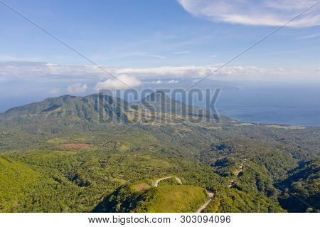 Mountain Landscape On The Island Camiguin, Philippines. Thick Rainforest On The Hills In Sunny Weath
