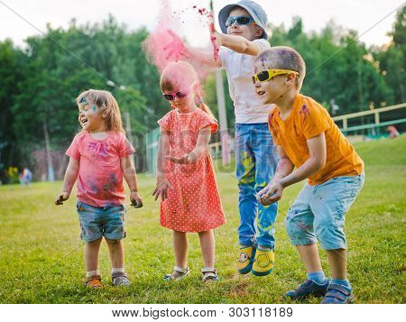 Children Preschoolers Throw Fun Outdoor Powder Paint Holly Wearing Sunglasses. Childrens Holiday, Ac