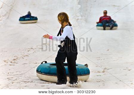 Young Girl Snow Tubing