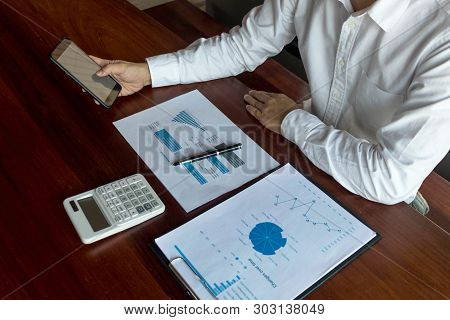 Businessman Using Smartphone To The Situation On The Market Value , Business Concept.