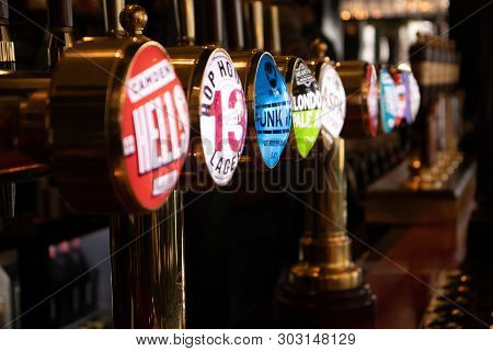 London, England - April 1, 2019: Draught Beer Taps In A Traditional Pub In London, Uk