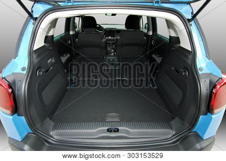 Empty Trunk With Rear Seats Folded Of The Small Passenger Car