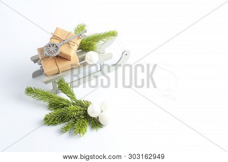 Christmas Sleigh With Gifts. New Years Concept. Decorative Toys In The Form Of Silver Key, Balls And