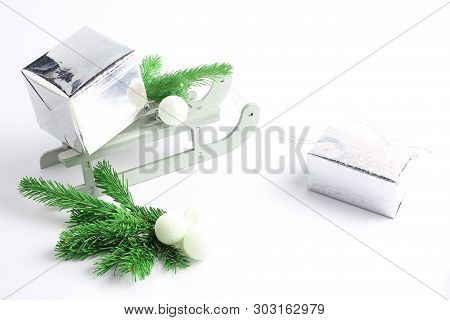 Glittery Paper Gifts Boxs. Christmas Sleigh With Gifts. New Years Minimal Concept.