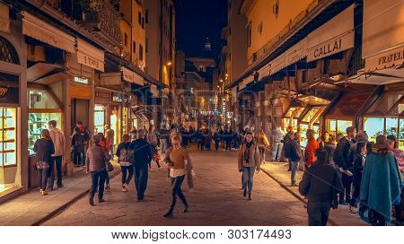 Florence, Italy - November 12th: People Walking On City Street In Downtown Florence, Italy At Night