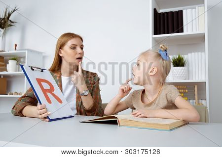 Speech Therapy Concept. Patient Kid With Female Therapist Training Pronunciation.
