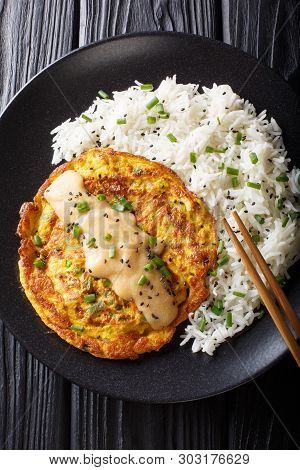 Chinese Omelette Egg Foo Young Served With Rice Close-up. Vertical Top View
