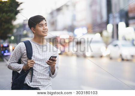 Young Traveler Browsing Gps Online Maps Application.