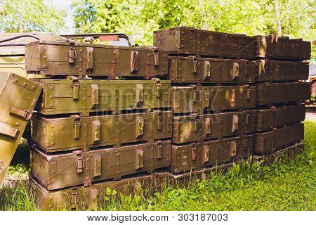 Military Green Boxes With Dangerous Explosives, Guns And Military Weaponry, Ready For Shipping, In A
