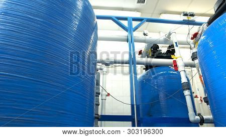 Industrial Water Filters. White Pipes And Red Valves. Purification Of Water At Plant. Newest Equipme
