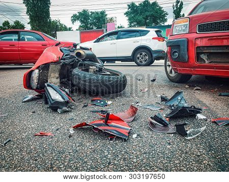 Motorcycle Bike Accident And Car Crash, Broken And Wrecked Moto On Road.
