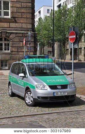 Dresden, Germany - May 10, 2018: Germany Police Volkswagen Touran Car Parked In Germany. Saxony Regi