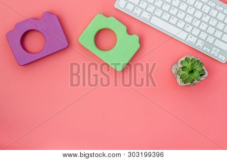 Blogger Table Design With Photo Camera, Keyboard And Plant On Red Background Top View Mockup