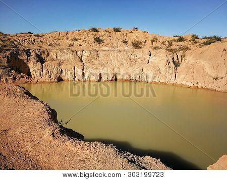 Small water lake at semi precious gems mostly sapphire mine at Ilakaka, Madagascar poster