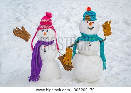 Two Snowman On Snow Background. Snowman Couple In Love Have Fun Christmas Or New Year. Happy New Yea