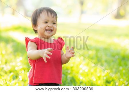 Portrait Face Of Cute Asian Little Girl And Child Happiness And Fun In The Park In The Summer, Smile