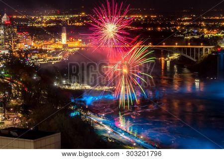 Niagara Falls, Canada - May 18-2019. Fireworks And Colorful Lights Illuminates The Waterfalls On Nia