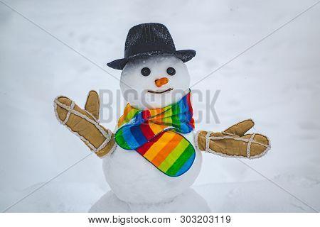 Cute Snowman At A Snowy Village. Snowman. Snowmen. Making Snowman And Winter Fun. Cute Little Snowma