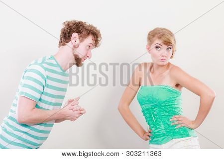 Conflicted Couple. Relationship Problem. Boyfriend Trying To Convince Girlfriend. Man Asking For For