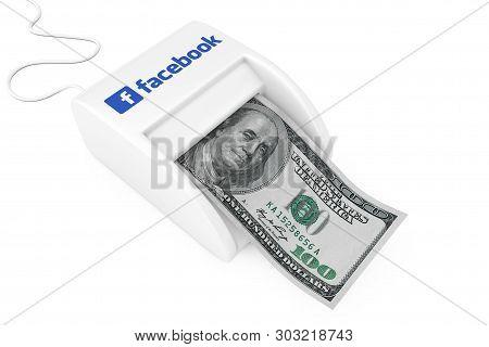 Kiev, Ukraine - May, 17: Make Money With Facebook Concept. Money Maker Facebook Machine With Dollars