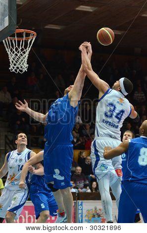 KAPOSVAR, HUNGARY – FEBRUARY 18: Michael Fey (white34) in action at a Hungarian Championship basketball game with Kaposvar (white) vs. Fehervar (blue) on February 18, 2012 in Kaposvar, Hungary.