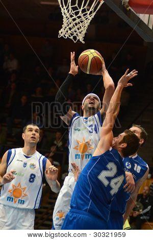 KAPOSVAR, HUNGARY – FEBRUARY 18:  Michael Fey (white, 34) in action at a Hungarian Championship basketball game with Kaposvar (white) vs. Fehervar (blue) on February 18, 2012 in Kaposvar, Hungary.