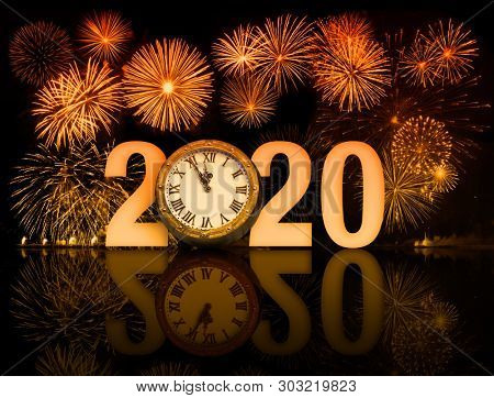 new year 2020 fireworks with clock face
