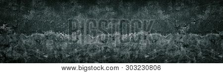 Old Shabby Black Half Painted Concrete Wall Texture. Wide Dark Grunge Panoramic Background