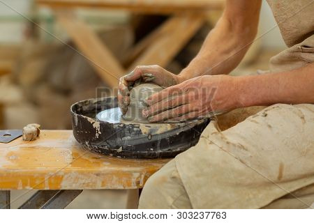 Practiced Hard-working Guy Being An Expert In Pottery Mastery