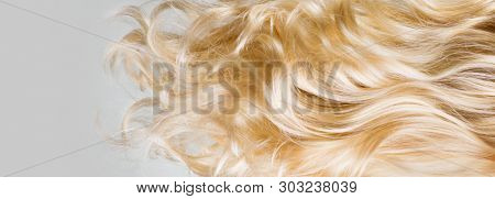 Hair. Beautiful healthy long curly blonde hair close-up texture. Dyed Wavy white hair background, coloring, extensions, cure, treatment concept. Haircare.  poster