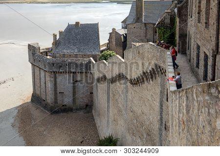 Le Mont-saint-michel, France - September 13, 2018: The Defensive Walls Of Mont Saint Michele, Having