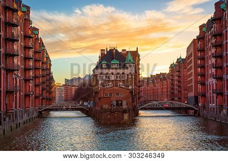The Warehouse District Speicherstadt During Sunset In Hamburg, Germany. Old Warehouses In Hafencity