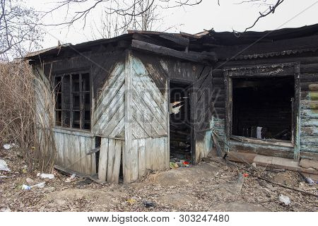 Country House After The Fire. The Skeleton Of A Burnt Wooden House. Broken Charred Dwelling. Broken