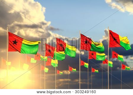 Nice Memorial Day Flag 3d Illustration  - Many Guinea-bissau Flags On Sunset Placed In Row With Soft