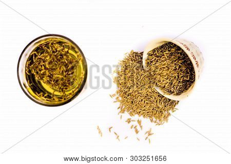 Herbal Detoxifying Drink Isolated On White I.e. Jeera Water With Some Raw Organic Cumin In A Glass B