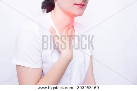 Young Caucasian Girl On A White Background Whose Pain And Inflammation In The Throat Concept Of Phar