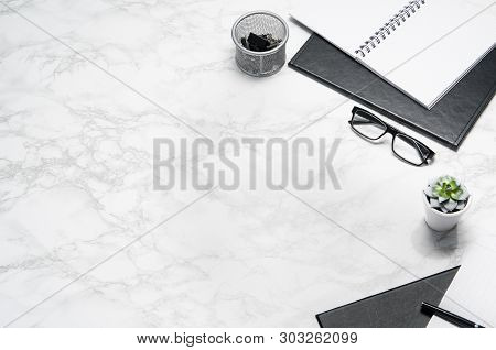 White Office Desk Table With Supplies Copy Space. Flat Lay