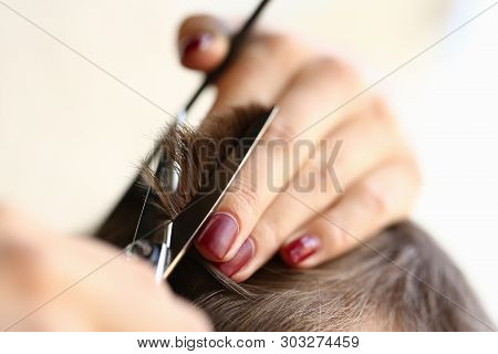 Female Fingers Trimming Male Hair By Scissors. Hairdresser Hands Cutting Haircut For Male. Woman Wit