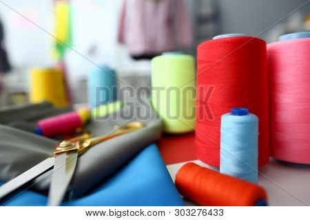 Clothes Designing Tailor Craftsmanship Concept. Fabric And Sewing Tools On Table. Needle Machine Bob