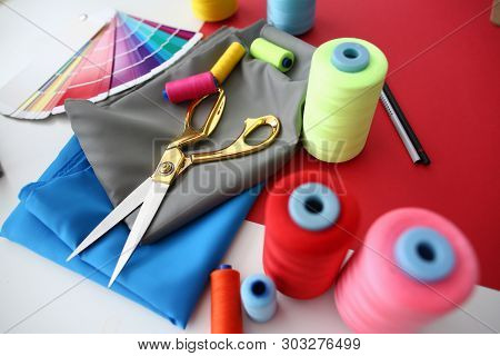 Fashion Designing Tailor Craftsmanship Concept. Fabric, Color Palette And Sewing Tools On Table. Nee