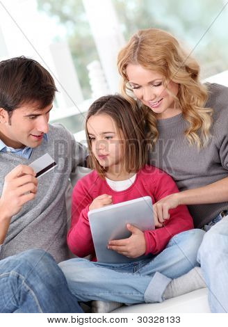 Family doing online shopping with tablet