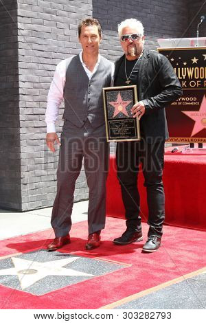 LOS ANGELES - MAY 22:  Matthew McConaughey, Chef Guy Fieri at the Guy Fieri Star Ceremony on the Hollywood Walk of Fame on May 22, 2019 in Los Angeles, CA