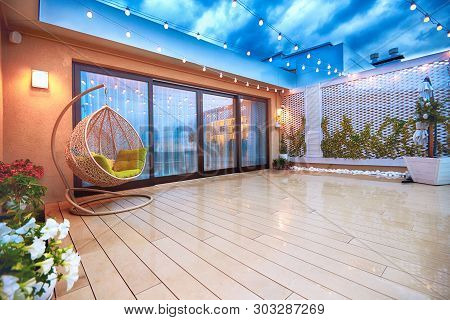 Evening Patio Area With Sliding Doors And Decking