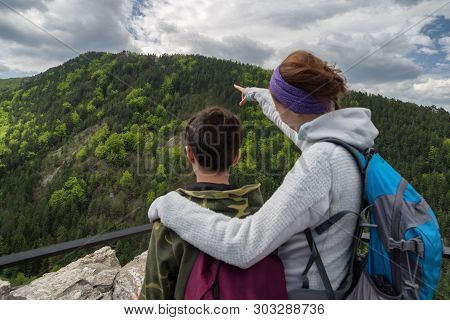 Woman And Boy Looking On Lookout Spicak From Strecno Castle, Slovakia