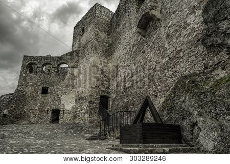 Courtyard At Strecno Caste In Slovakia. Dark Clouds Over Castle