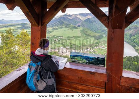 Woman Looking On Map At Lookout Spicak. Castle Strecno At Background. Slovakia