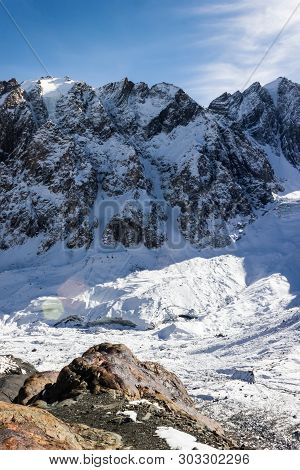 Mountain Under Snow And Blue Sky. Climbing The Rocks, Alipinism. Winter Panorama Of Altai Mountain G